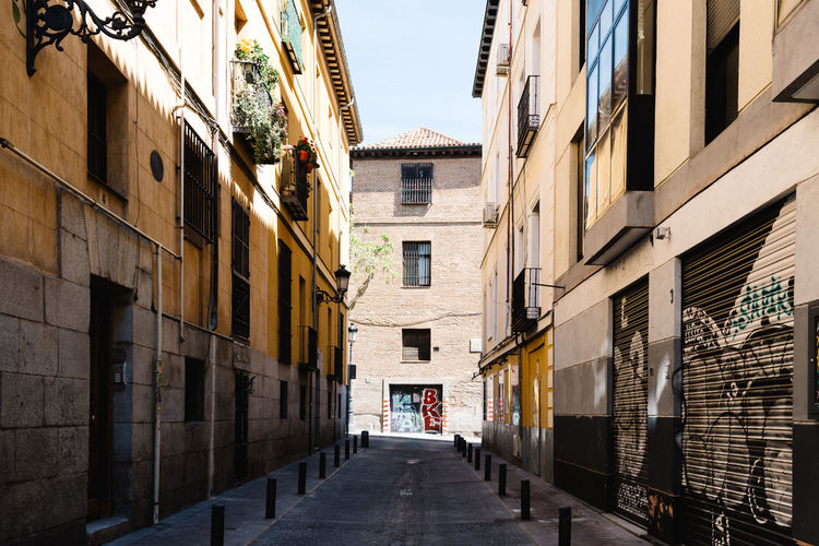 Quarter of Las Letras in Madrid Architecture Built Structure Building Exterior Building City Day Street Residential District Nature Sunlight Outdoors Direction The Way Forward Alley Old Quarter  Letras Urban Skyline City Cityscape Narrow Window No People Diminishing Perspective Wall - Building Feature Footpath