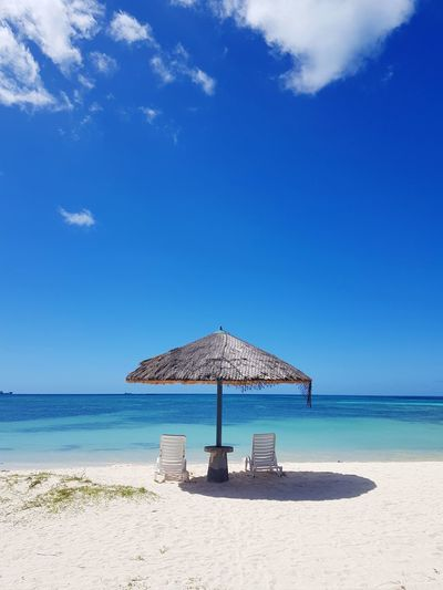 Paradise 🏖️ Beach Sand Sea Vacations Summer Protection Sunny Water Horizon Over Water Sky Blue Relaxation Day Outdoors Nature Travel Destinations Tranquility No People Cloud - Sky