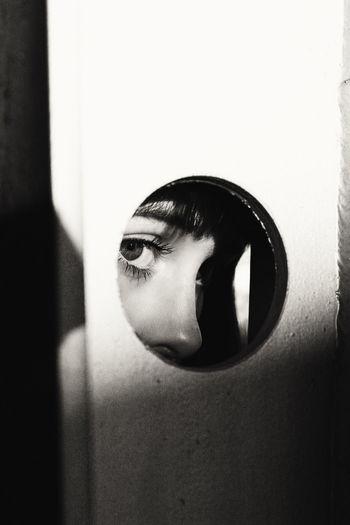Sunlight Falling On Thoughtful Teenage Girl Looking Through Hole