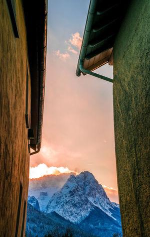 #cityview #mountains #zugspitze #sunset #alley #tunnelview #alps #snow #snowymountains #nopeople #garmischpartenkirchen Mountain Sunset Snow Sky Outdoors No People Nature