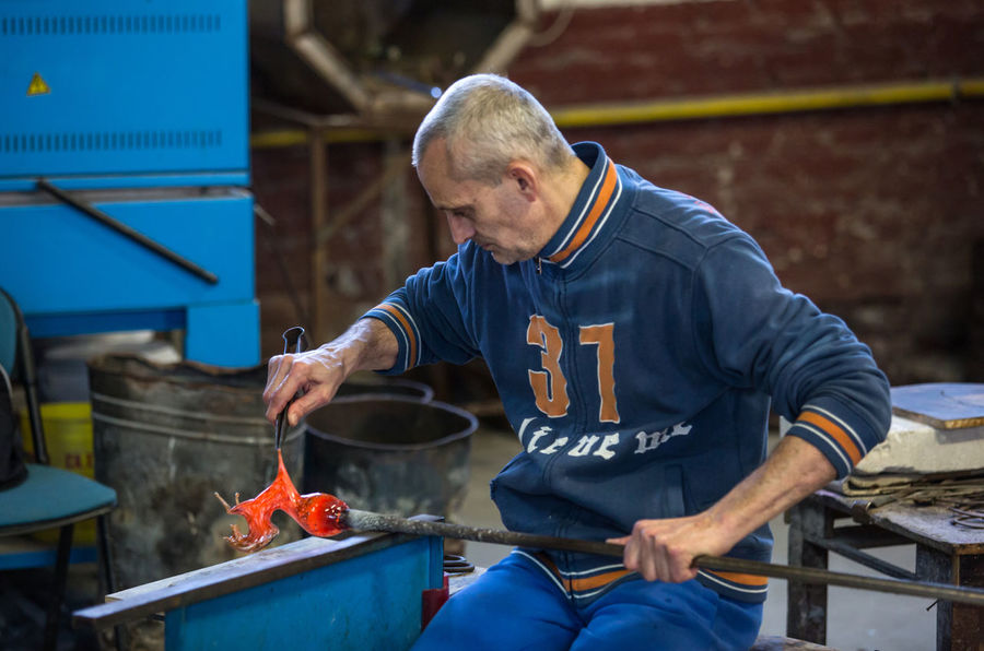 Adult Day Factory Glass - Material Glass Factory Indoors  Men Metal Industry Muranoglass Occupation One Person People Protective Workwear Real People Standing Steel Worker Working