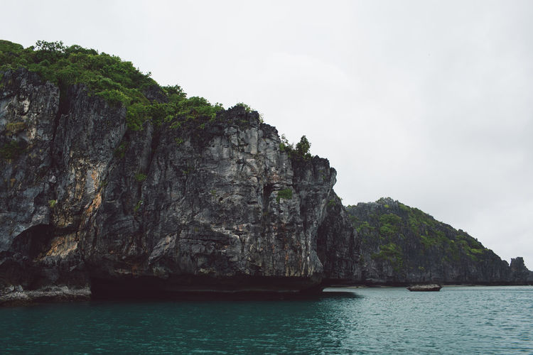 Water Sky Sea Beauty In Nature Scenics - Nature Waterfront Tranquility Rock Tranquil Scene Day Nature No People Cliff Rock - Object Nautical Vessel Mountain Rock Formation Land Solid Outdoors Formation