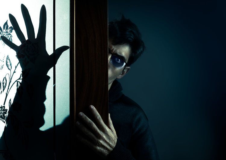 Diabolic man with glasses and long fingers. Psycho Shadows & Lights Evil Nightmare Fear Dark Hallowween Horror Night Darkness Frightening Mystery Haunted Scary Creepy Spooky Character Nosferatu Vampire Creature Sight Supernatural Hand Somber Devilish