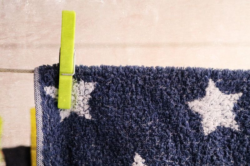 Close-Up Of Blue Towel Drying On Clothesline