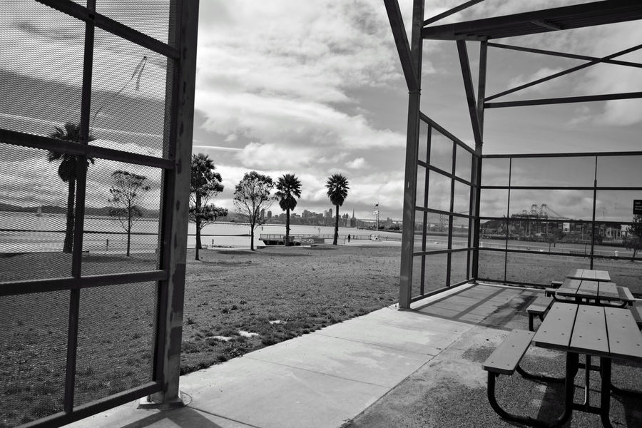 Middle Harbor's Picnic Concourse 4 Shoreline Park Port Of Oakland, Ca. Oakland Estuary Lowtide  Port Cranes Trees Bnw_friday_eyeemchallenge Band Stand Open Spaces Flag Pole Picnic Tables Sailboats kSan Francisco Skyline Bay Bridge Ferry Building Transamerica Pyramid Building Angled Canopy Angles Geometric Patterns Pattern Pieces Black & White Black & White Photography Black And White Black And White Collection  Monochrome Photograhy