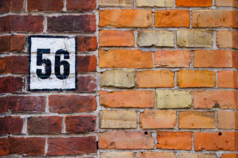 Postal numbet 56 on a brick wall 56 Architecture Backgrounds Brick Brick Wall Building Exterior Built Structure Close-up Day No People Outdoors Red Wall - Building Feature
