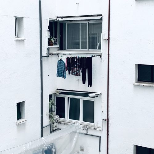 Clothes drying on wall of building
