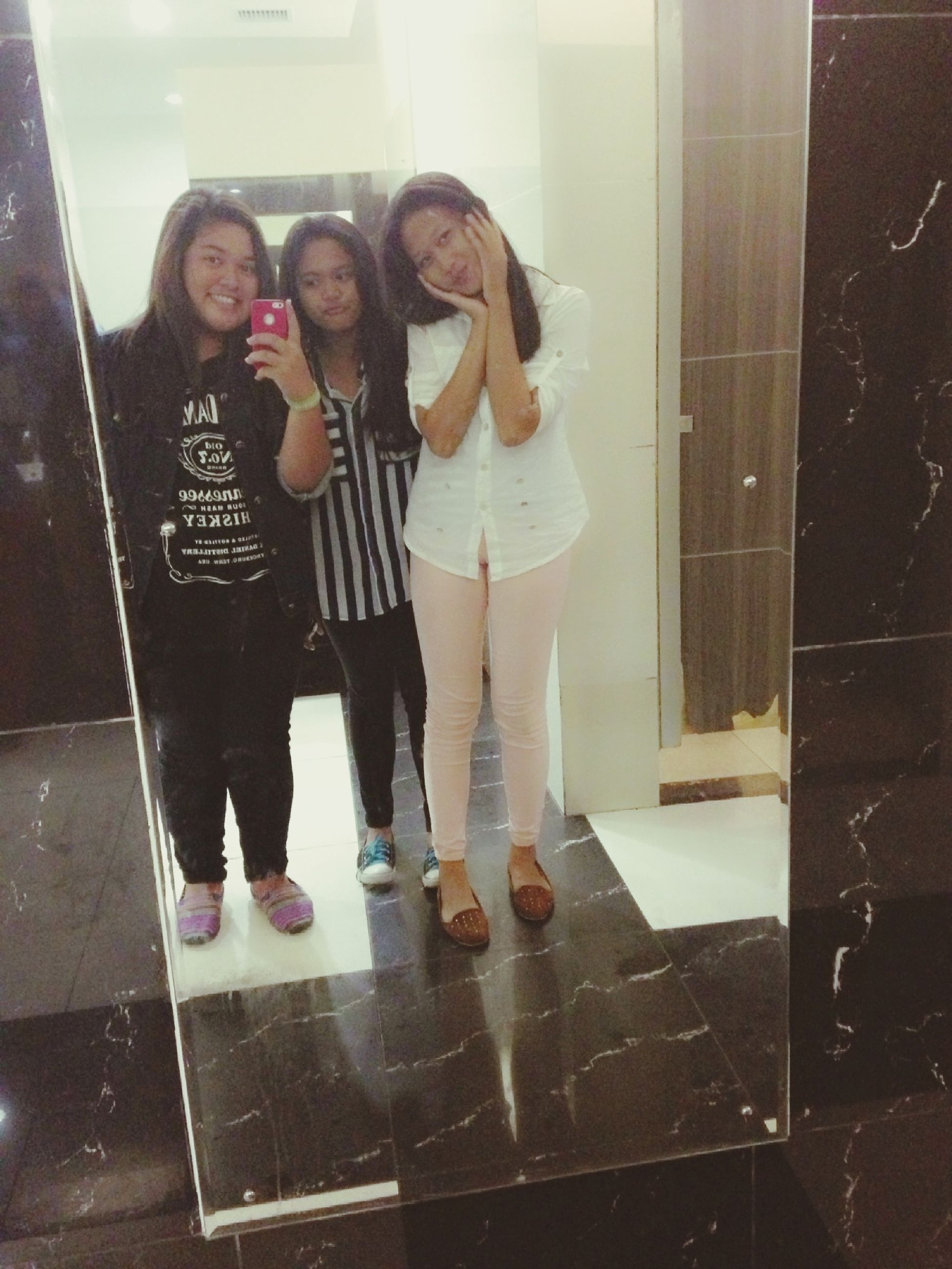 lifestyles, indoors, full length, casual clothing, standing, leisure activity, young adult, person, young women, reflection, front view, tiled floor, flooring, sitting, three quarter length, mirror, wall - building feature