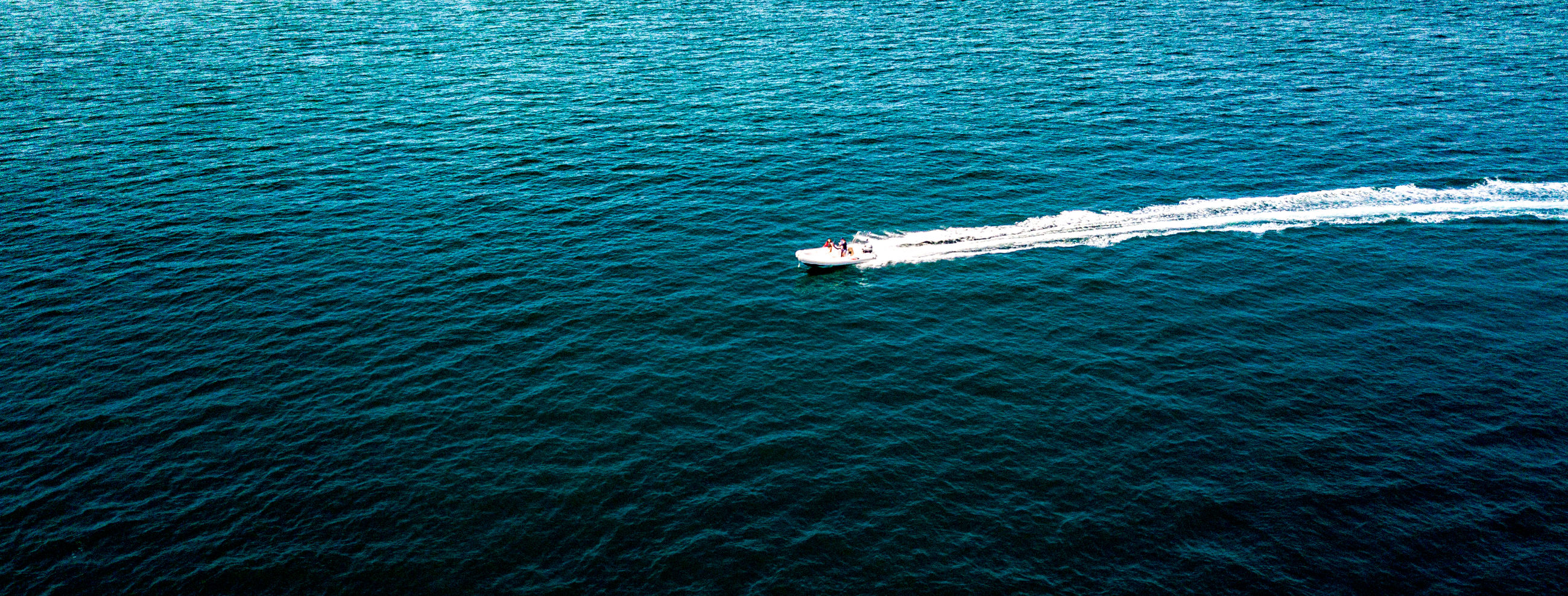 sea, water, nautical vessel, motion, high angle view, blue, day, waterfront, no people, transportation, nature, wave pattern, beauty in nature, scenics - nature, mode of transportation, outdoors, rippled, wake - water, sport, turquoise colored, marine