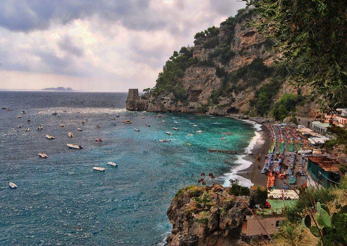 Amalfi Coast Beauty In Nature Cliff Cloud - Sky Coastline Idyllic Italy Mountain Positano Rock Formation Scenics Sea Shore Sky Tranquil Scene Travel Destinations Water