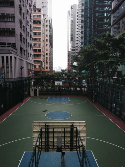 Basketball Court in Hong Kong Games Highrises Lonely Urban Scene Cityscape City Life Playground Urban Basketball City Sports Play Dense Outdoor Play Equipment Net - Sports Equipment Office Building