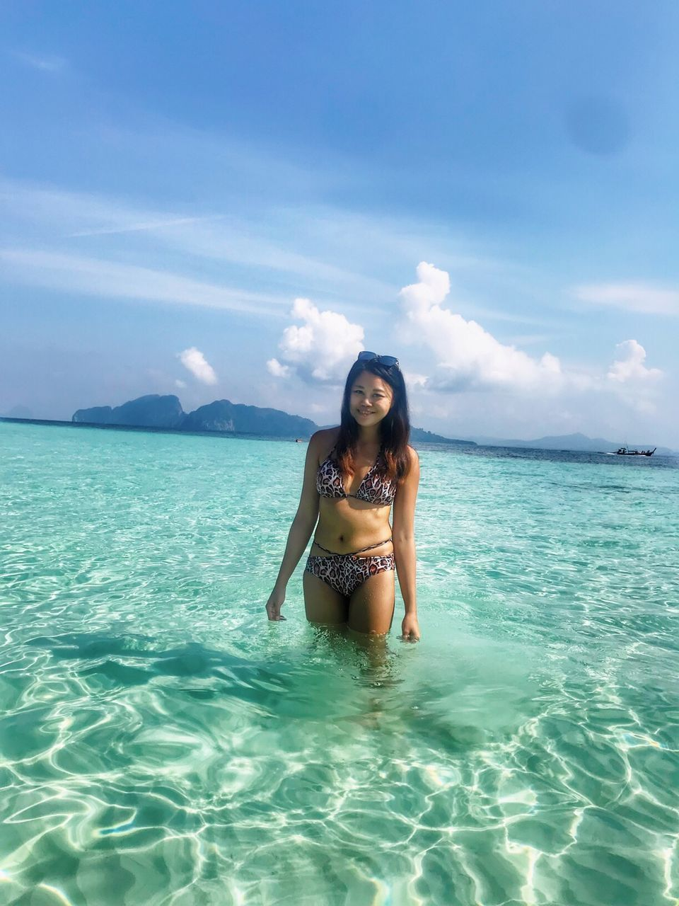one person, young adult, sea, sky, water, young women, leisure activity, portrait, front view, lifestyles, beauty in nature, beautiful woman, real people, beauty, adult, standing, looking at camera, swimwear, scenics - nature, hair, hairstyle, turquoise colored, horizon over water, outdoors