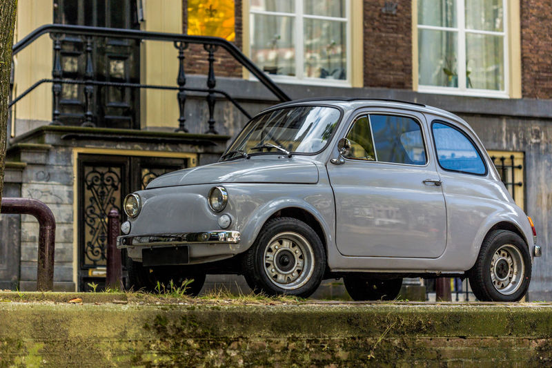old Fiat500 car in Amsterdam Amsterdam Automobile City Life Classic Classic Car Fiat Amsterdamcity Automotive Car Cute Eye4photography  Fiat500 Grey Mode Of Transport Old Oldtimer Side View Small Car Transportation