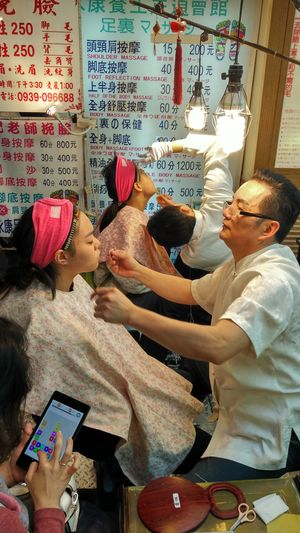 Face threading on the five-foot way at Raohe Night Market in Taipei, Taiwan. Business Cosmetics Culture, Face Threading Night Market, Sitting Taipei, Taiwan Working