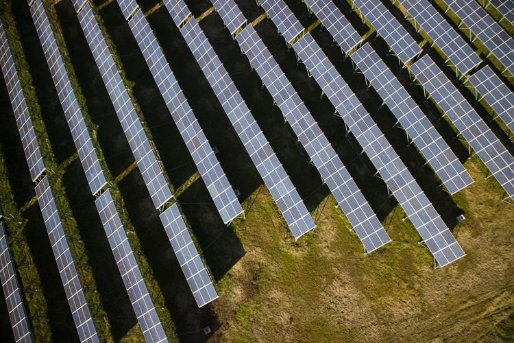 Pattern Day Architecture Solar Panel No People Solar Energy Nature Built Structure Repetition Side By Side In A Row Outdoors Renewable Energy Alternative Energy Sunlight Technology Environmental Conservation Building Exterior Fuel And Power Generation High Angle View