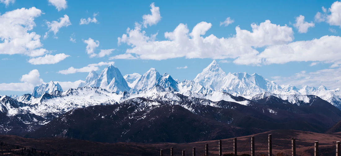 Blue sky, white clouds, snowy mountains China Landscape Mountain Sky Cloud - Sky Beauty In Nature Nature Scenics - Nature Travel Destinations Travel Snowcapped Mountain Environment Tranquil Scene Mountain Range Tranquility Snow No People Cold Temperature Non-urban Scene Mountain Peak Day