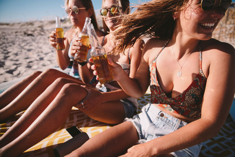 Drink Friendship Leisure Activity Group Of People Refreshment Alcohol Lifestyles Summer Bikini Enjoyment Food And Drink Swimwear Adult Fun Holiday Trip Women Vacations Drinking Celebratory Toast Outdoors Glass