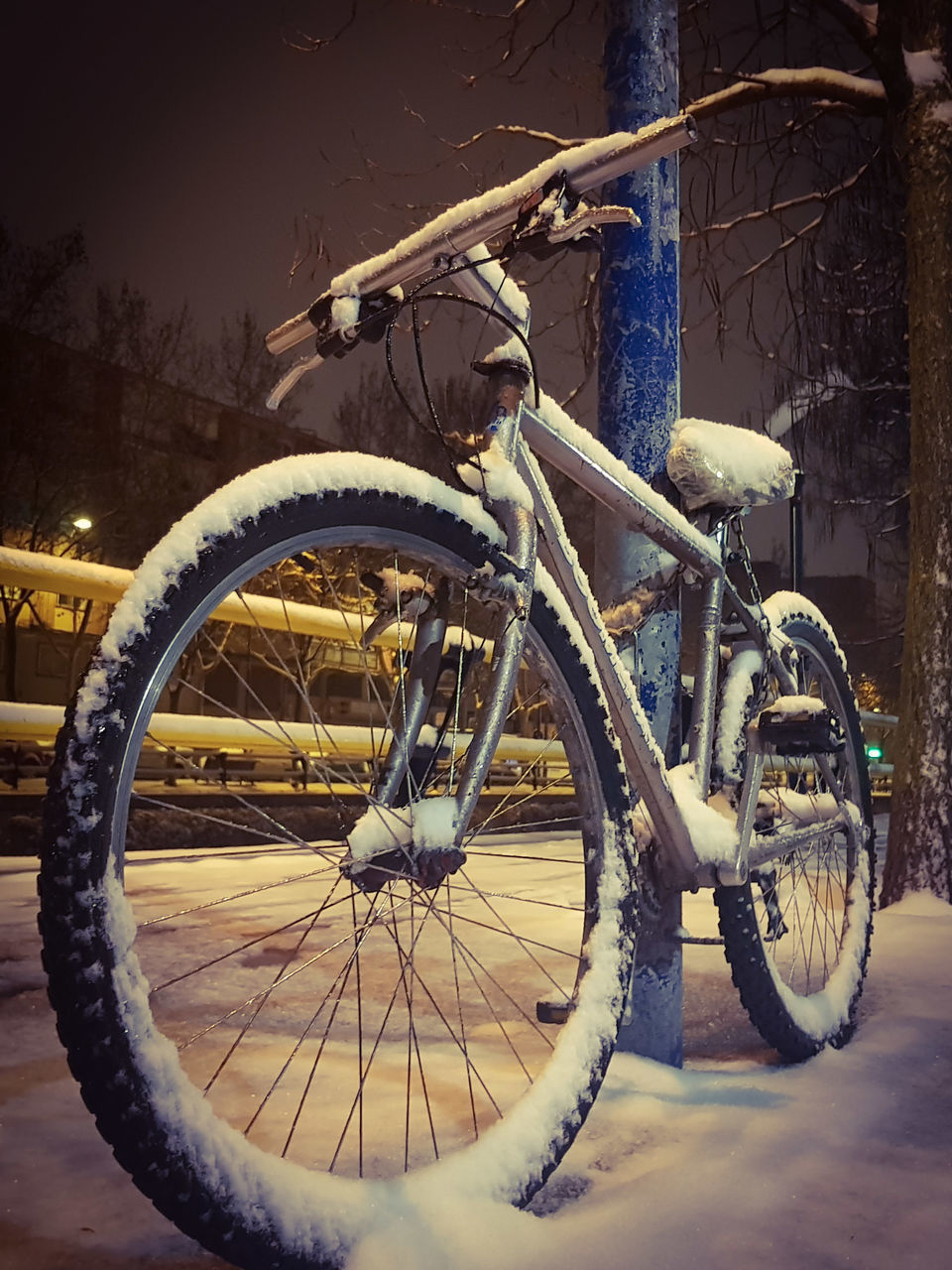 CLOSE-UP OF BICYCLE PARKED ON SNOW COVERED CAR