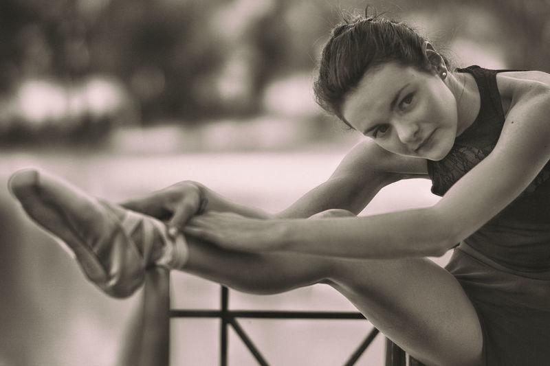 Portrait of young ballet dancer exercising