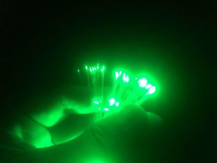 Green light over fiber optic Fiber Optic Green Green Color Illuminated Glowing Technology Night Light Beam Studio Shot No People Close-up Indoors
