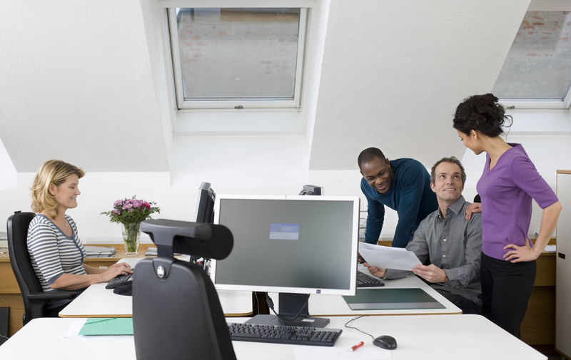 Group of people using laptop on table