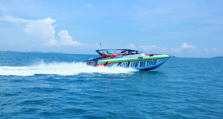 Transportation Nautical Vessel Motion Mode Of Transportation Sea Water Travel Speed Sky on the move Nature Cloud - Sky Waterfront Day Sailing People Beauty In Nature Men Outdoors