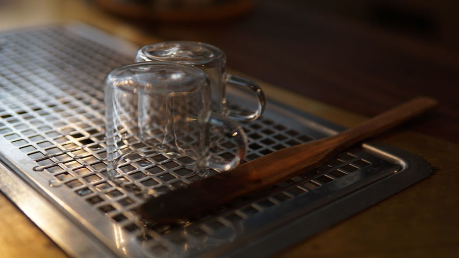 Close-Up Of Glass Cups And Wooden Spoon On Table