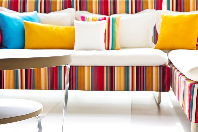 Multi colored chairs on table at home