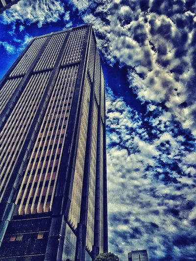 Low angle view of skyscraper against sky
