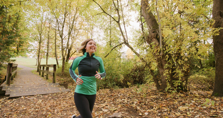 Adult Adults Only Autumn Day Exercising Forest Healthy Lifestyle Jogging Leaf Lifestyles Mid Adult Nature One Person One Woman Only Only Women Outdoors People Real People Running Sports Clothing Tree Wellbeing Women Young Adult Young Women