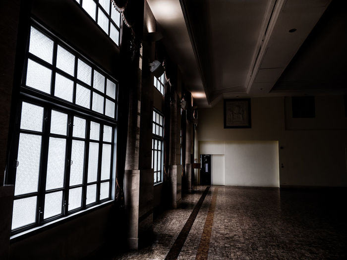 A long way of darkness and light. Corridors  Halloween Horror Shadow And Light Architecture Black And White Building Built Structure Corridor Darkness And Light Day Hospital Indoors  Interior Design Long Way To Go... Misterious Mistery No People Prison Sepia Shadow Window