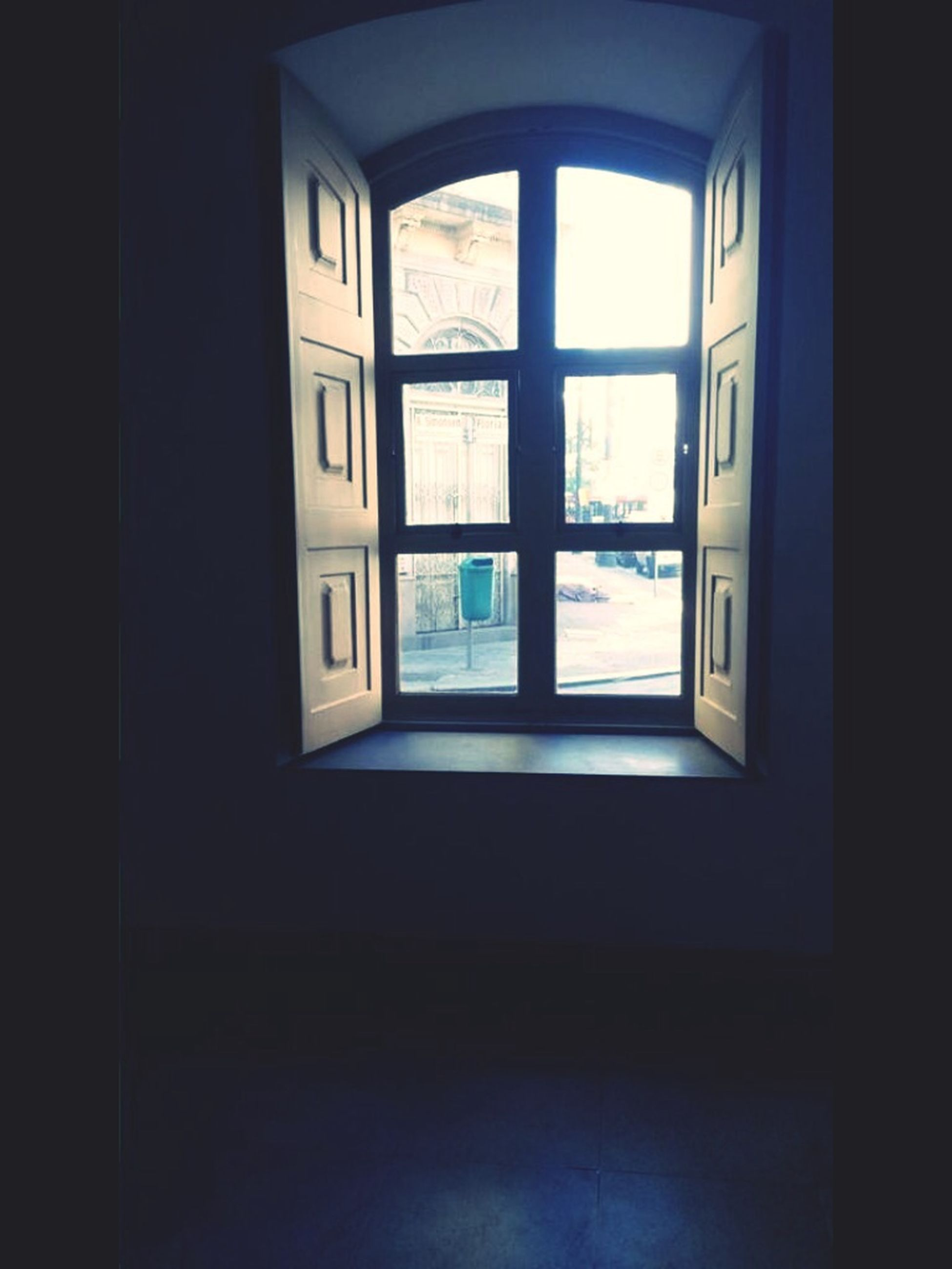window, indoors, glass - material, architecture, transparent, built structure, day, reflection, door, water, house, open, transportation, no people, sunlight, empty, looking through window, building, absence, building exterior