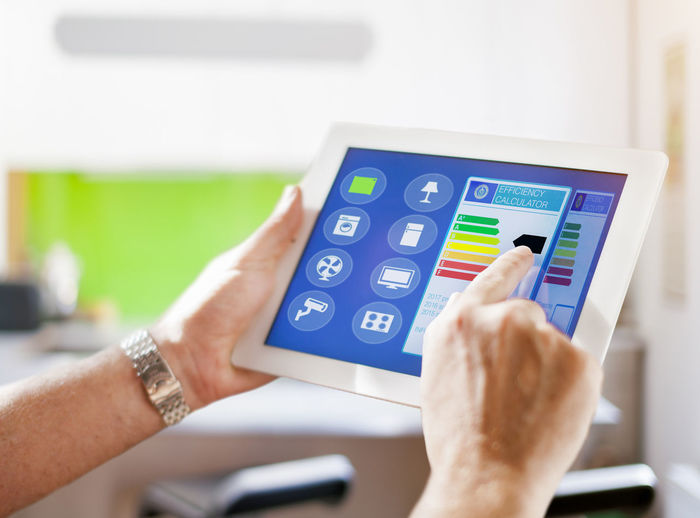 Home Automation Close-up Day Device Screen Focus On Foreground Holding Human Body Part Human Hand Indoors  Innovation One Person People Real People Smart Home Tablet Pc Technology Touch Screen Wireless Technology