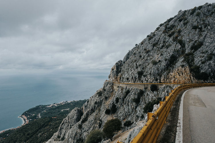 High Angle View Of Mountain Road By Seaside