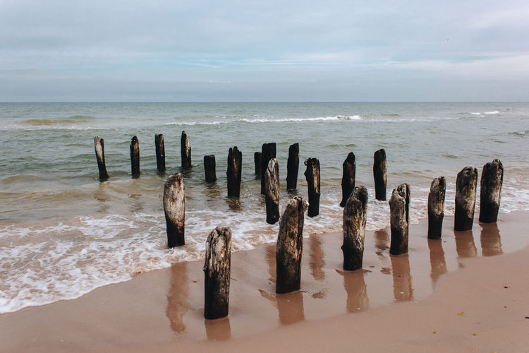 Latvia Latvija Beach Beauty In Nature Horizon Horizon Over Water Land Motion Nature No People Outdoors Post Sand Scenics - Nature Sea Sky Tranquil Scene Tranquility Ventspils Water Wave Wood - Material Wooden Post