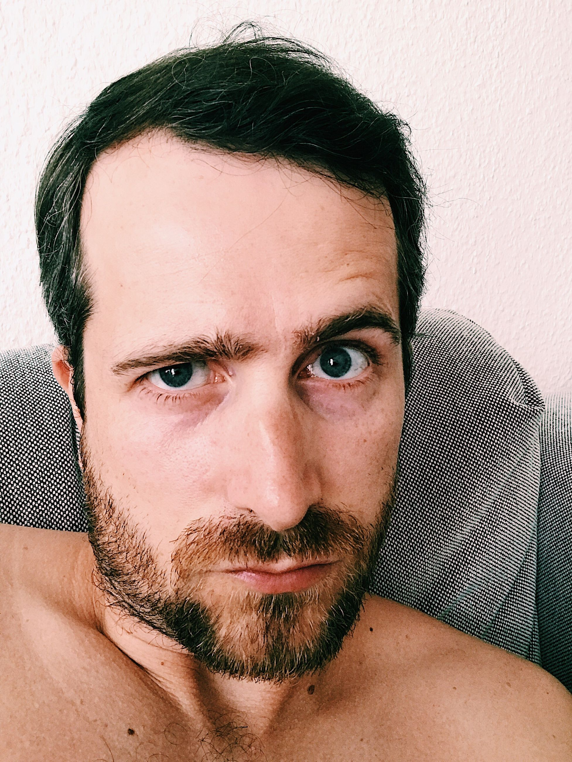 looking at camera, portrait, beard, one person, headshot, mid adult, close-up, mustache, real people, one man only, shirtless, human face, handsome, indoors, lifestyles, men, only men, adult, day, adults only, people, young adult