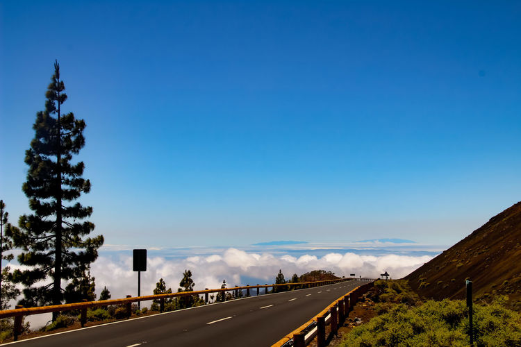 road trip...... Tenerife Travel Travel Destinations Summer Vacations Roadtrip Clouds And Sky Cloud - Sky Cloud Natural Beauty Beauty In Nature Beautiful Nature Beautiful Day Relaxing Idyllic Tranquility Relaxing Enjoying Life Sky SPAIN EyeEm Selects Tree Road Blue Road Sign Sky Empty Road Mountain Road Tranquil Scene Scenics The Traveler - 2018 EyeEm Awards Summer Road Tripping