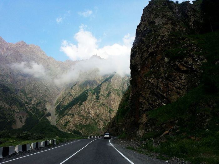 Car on street amidst mountains