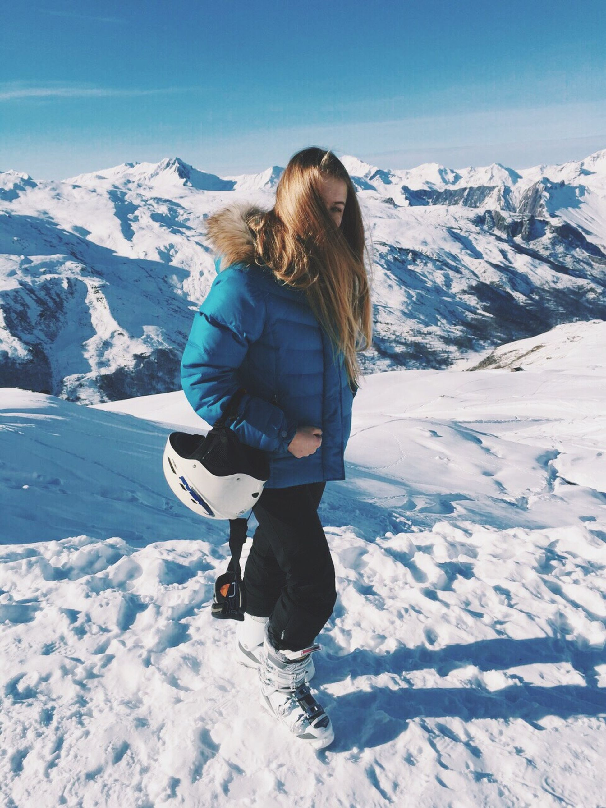 snow, winter, cold temperature, season, mountain, leisure activity, full length, weather, lifestyles, landscape, warm clothing, snowcapped mountain, mountain range, tranquil scene, covering, tranquility, scenics, beauty in nature