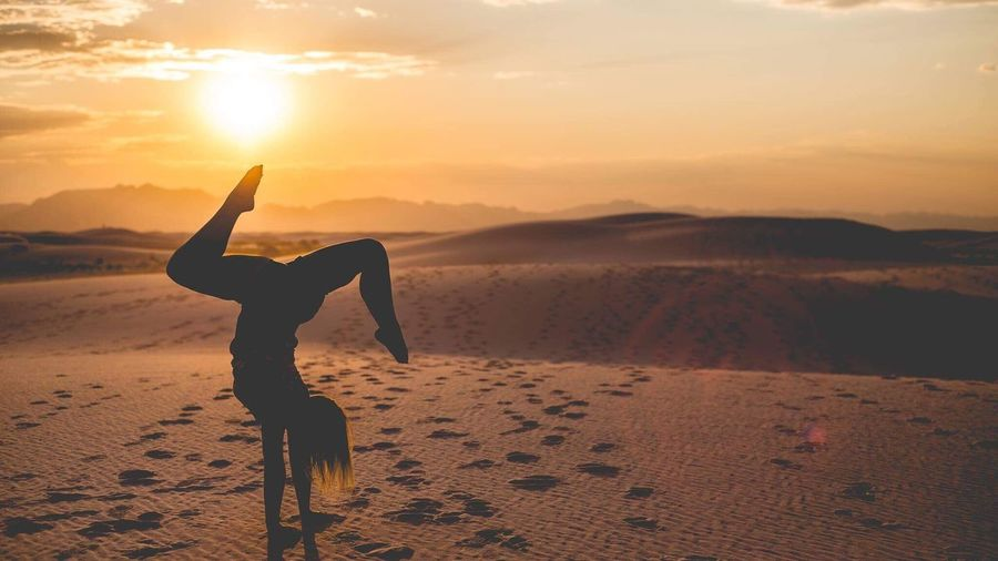 Sunset Exercising Sand Whitesandsnationalmonument One Person Silhouette Tranquil Scene Yoga Healthy Lifestyle Nature Desert Beauty In Nature Lifestyles Leisure Activity Outdoors Sunlight Flexibility Landscape Full Length Scenics
