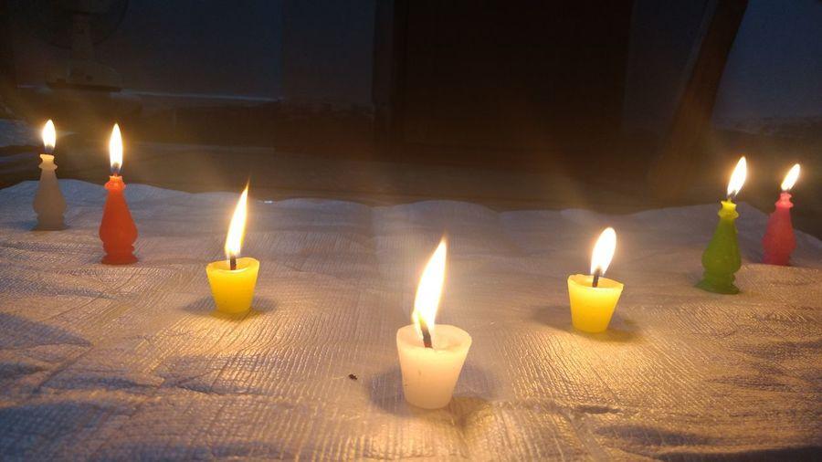 Close-up of candles burning at home