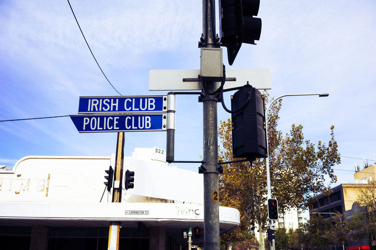 Irish Club Police Club Traffic Signs Irish Police Blue Sky And Clouds Traffic Arrow Sign Road Warning Sign Street Name Sign Directional Sign Information Information Sign Board Exit Sign Road Signal Signboard