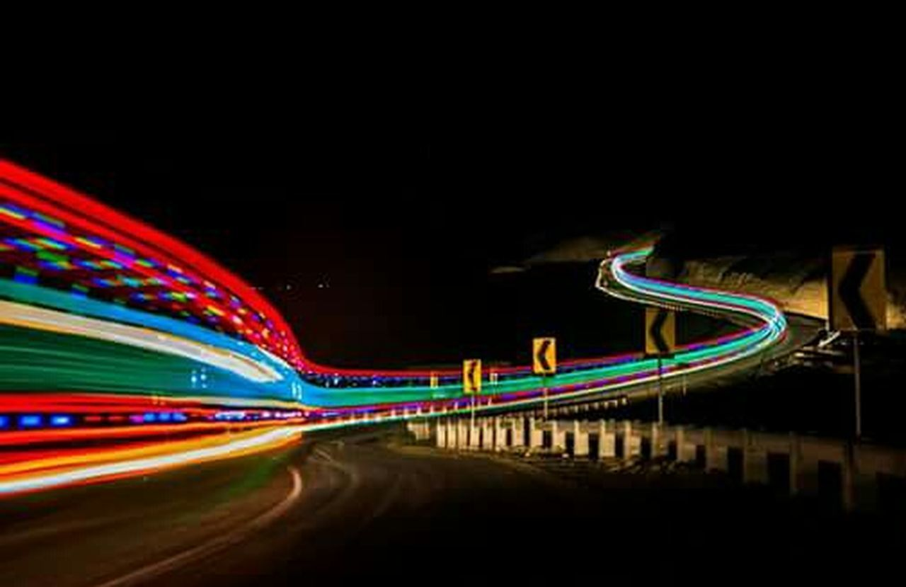 speed, light trail, night, motion, long exposure, blurred motion, transportation, road, traffic, illuminated, street, no people, curve, neon, outdoors, city