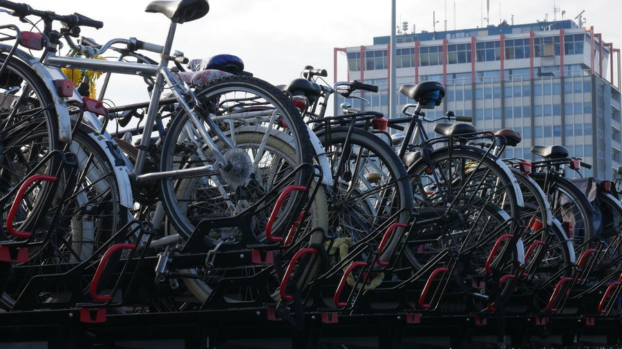 Low Angle View Of Bicycles Parked By Building