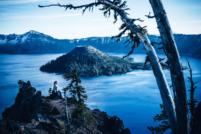 Crater Lake, Oregon. The deepest and bluest lake in the U.S Beauty In Nature Beauty In Nature Blue Cold Crater Lake Crater Lake National Park Deepest Lake In The US Dusk Lake Landscape Mountain Nature Nature One Person Oregon Outdoors Reflection Sky Snow Sunset Volcano Winter Woman Young Adult TCPM The Great Outdoors - 2017 EyeEm Awards Lost In The Landscape Shades Of Winter An Eye For Travel Love Yourself