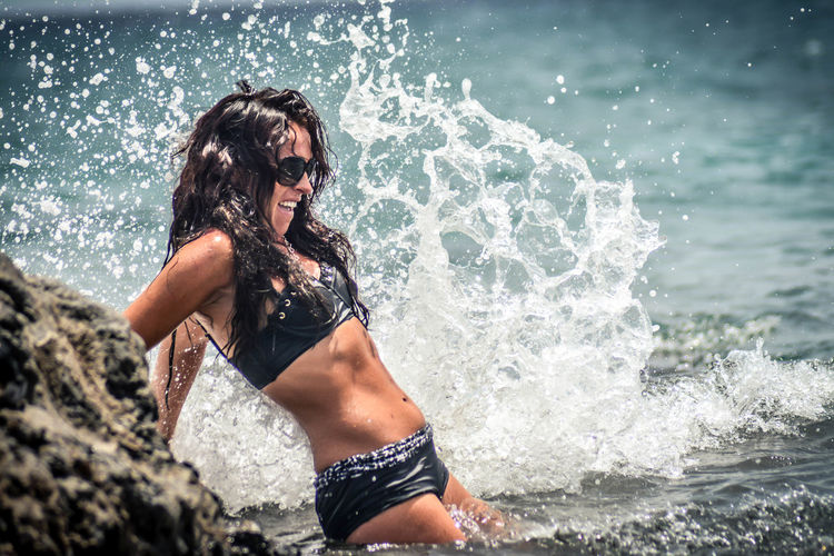 Beach Beautiful Woman Beauty Beauty In Nature Bikini Day Leisure Activity Lifestyles Motion Nature One Person Outdoors Power In Nature Real People Sea Splashing Standing Summer Sunlight Surf Vacations Water Wave Young Adult Young Women Be. Ready. EyeEm Ready   Summer Exploratorium