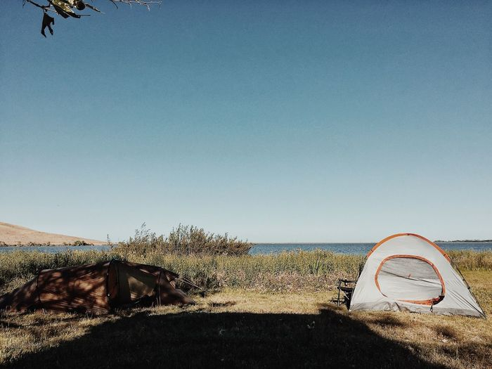Camping Picnic Camp Camping EyeEm Selects Clear Sky Beach Sand Day Nature No People Outdoors Landscape Grass Sea