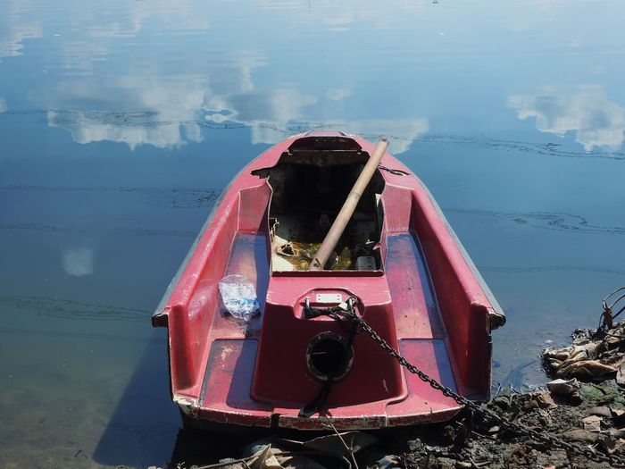 Broken red boat Water Nature Reflection Day No People Mode Of Transportation Transportation High Angle View Beauty In Nature Sunlight Land Old Tranquility Outdoors Nautical Vessel Lake Red Technology