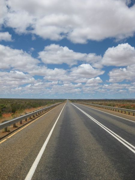 Cloud - Sky The Way Forward Direction Road Diminishing Perspective Road Marking vanishing point No People Landscape Day Outdoors Dividing Line Long Land Transportation Straight Street Onward Perspective Horizon Horizon Over Land Puffy Clouds Clouds And Sky Clouds Australia