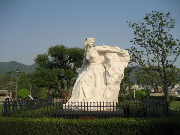 Maiden of Peace. Monument donated to Nagasaki in 1985 by the People's Republic of China. White Statue Clear Sky Nagasaki Nagasaki Peace Park Peace Clear Sky Dove Female Likeness Outdoors Statue Human Representation